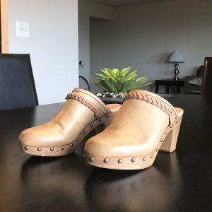 Report high heel clogs